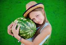 Teen girl in a straw hat holding a large watermelon. Girl teenag. Er smiling stock image