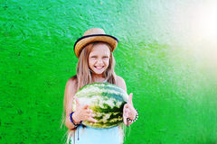Teen girl in a straw hat holding a large watermelon. Girl teenag. Er smiling stock photos
