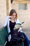 Teen Girl studies. Teenage high school student studies before class outside on a bench Royalty Free Stock Photos