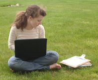 Teen Girl Studies on Lawn Stock Photo