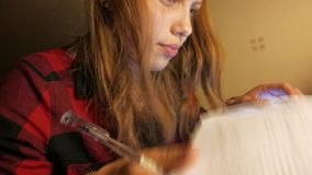 Teen Girl Studying. 4K UHD stock footage