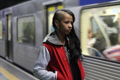 Teen girl by subway train Stock Photography