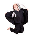Teen girl in suit jumping Stock Image