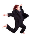 Teen girl in suit jumping Royalty Free Stock Images