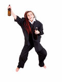 Teen girl in suit jumping Royalty Free Stock Photography