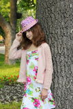 Teen girl in a summer hat Stock Images