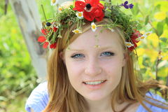 Teen girl in summer wreath Royalty Free Stock Photo