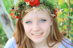 Teen girl in summer wreath Royalty Free Stock Image