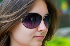 Teen girl in sunglasses. Portrait of a beautiful teenage girl in sunglasses Royalty Free Stock Image