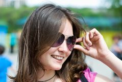 Teen girl in sunglasses. Portrait of a smiling beautiful teenage girl in sunglasses Royalty Free Stock Photography