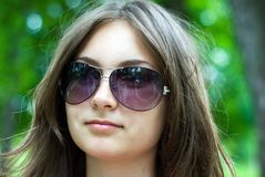 Teen girl in sunglasses. Portrait of a beautiful teenage girl in sunglasses Royalty Free Stock Photo