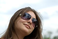 Teen girl in sunglasses. Portrait of a beautiful teenage girl in sunglasses Royalty Free Stock Images