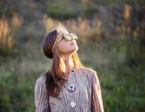 Teen girl in sunglasses outdoor. The teen girl in sunglasses outdoor stock image