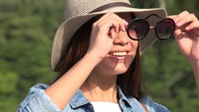 Teen Girl Sunny Day Puts On Sunglasses stock footage