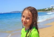 Teen girl surfing on tropical beach. Child on surf board on ocean wave. Active water sports for Teenager royalty free stock image