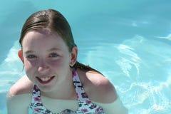 Teen girl swimming. Teen girl having fun swimming royalty free stock photo