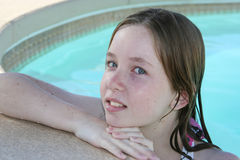 Teen girl swimming Royalty Free Stock Photos