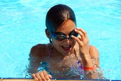 Teen girl in swimming pool portrait Royalty Free Stock Images