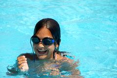 Teen girl in swimming pool portrait Royalty Free Stock Photography