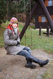 Teen girl on swing. In winter stock photos