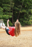 Teen girl on the swing-back showing Stock Photo