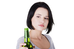 Teen girl taking beer Royalty Free Stock Photography