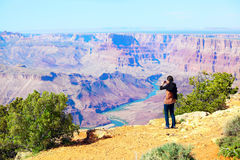 Teen girl taking pictures at the Grand Canyon Stock Photos