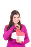 Teen girl taking valentine out of envelope Stock Photos