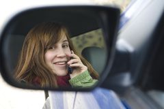 Teen girl talking on a cell phone in a car Stock Images