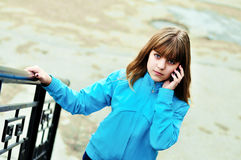 Teen girl talking by mobile Royalty Free Stock Image