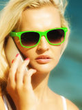 Teen girl talking on mobile phone on beach Royalty Free Stock Image