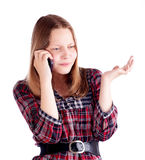 Teen girl talking on the mobile phone and resent Royalty Free Stock Photography