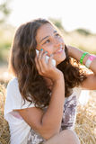 Teen girl talking on  phone outdoors Stock Images