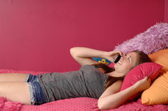 Teen girl talking on telephone Stock Images