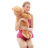 Teen girl with teddy bear Royalty Free Stock Photos