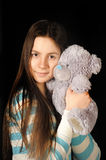 Teen girl with teddy bear Stock Photography