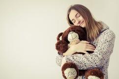 Teen girl with teddy bear stock image