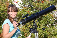 Teen girl and telescope Royalty Free Stock Photo