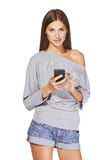 Teen girl text messaging on her mobile Royalty Free Stock Photo