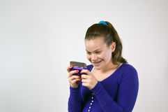 Teen girl texting Royalty Free Stock Photos