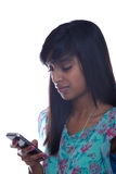Teen girl texting. Indian teen girl sending text on phone Royalty Free Stock Images