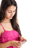 Teen girl texting. Portrait of a mixed race teen girl texting isolated on white Stock Images