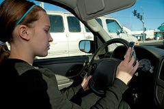 Teen girl texting while driving Royalty Free Stock Photos