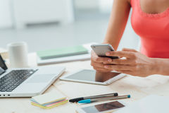 Teen girl texting with her mobile phone stock image