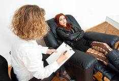 Teen girl on therapy. Troubled teen girl on therapy or counseling session Stock Images