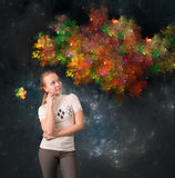 Teen girl thinking something about. On abstract background with fractals Royalty Free Stock Photos