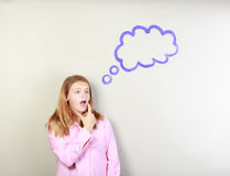 Teen girl thinking Royalty Free Stock Images