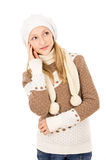 Teen girl thought a hat and scarf Stock Photos