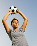 Teen girl throwing in soccer ball Stock Image