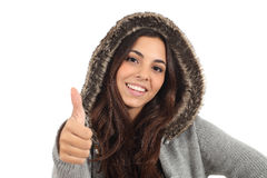 Teen girl with thumb up and smiling. On a white isolated background Royalty Free Stock Image
